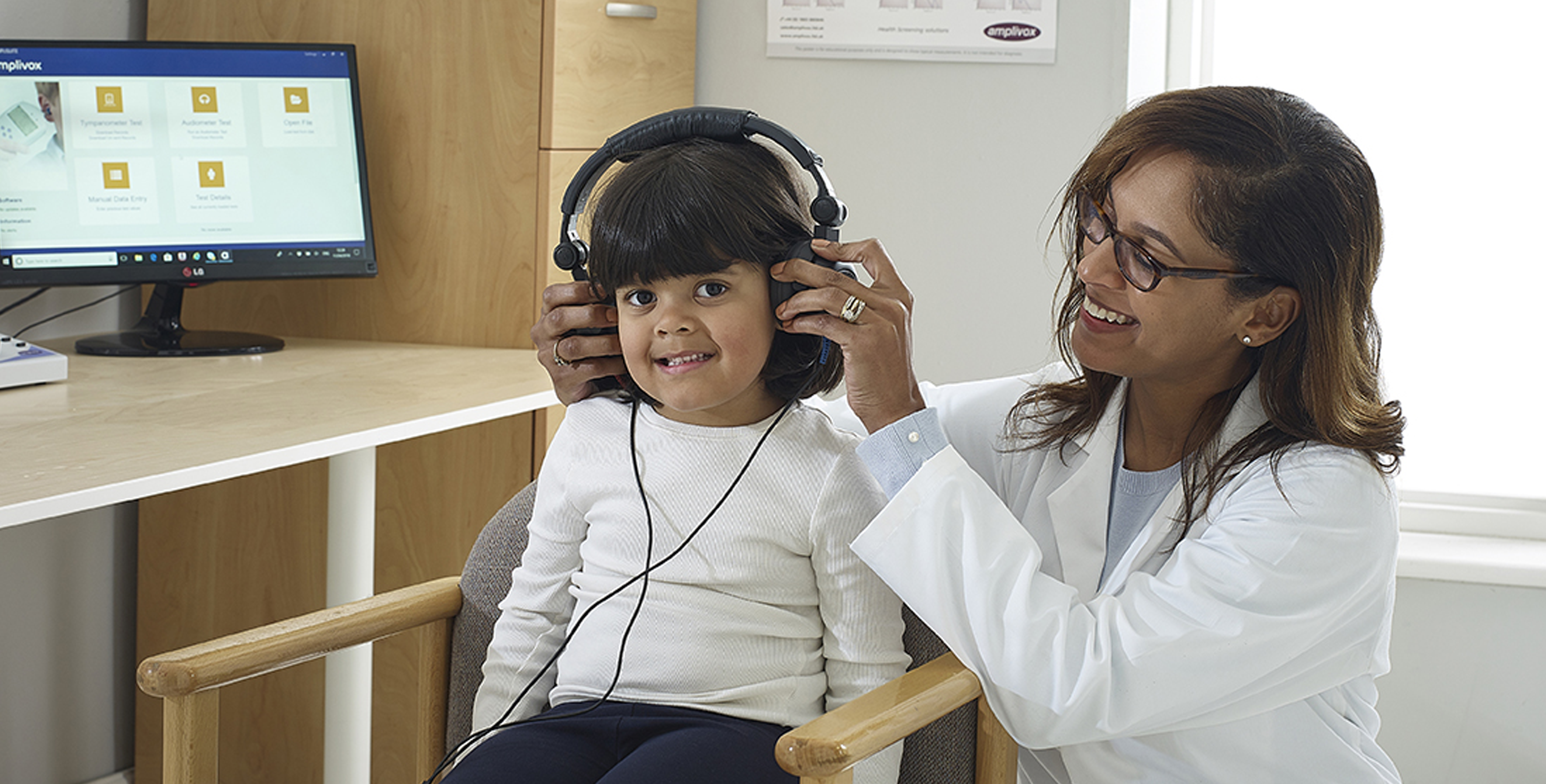 Audiologist with Child Patient