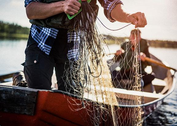 man-fishing-boat-co2-emision