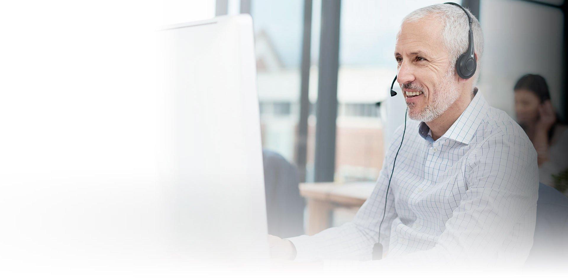 A man from Diatec Diagnostics talking into his headphones, looking into a computer screen