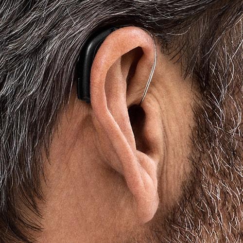 bte-hearing-aid-being-worn-min