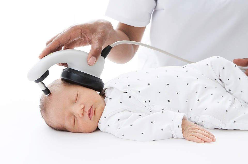 Close-up of sleeping baby while an ABR hearing test is conducted babyfriendly with a MAICO MB 11 BERAphone
