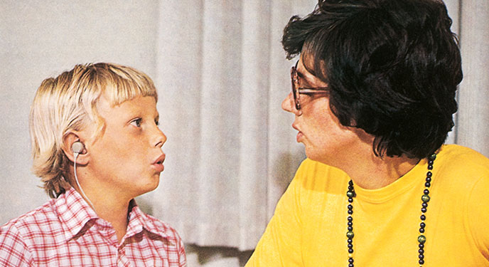 adult and child with hearing aids