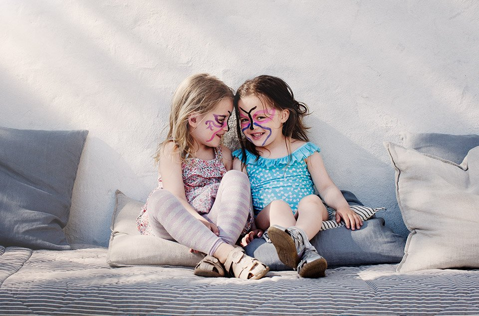 Two pre-school aged girls laughing