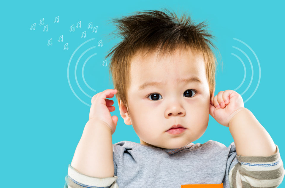Kid of two years touching ears